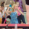Record-Eagle/Jan-Michael Stump<br /> Members of the Young Americans lead Kennedy Eichstadt, left; Olivia Duell; and other students in a dance workshop for area students at Traverse City Christian High School on Monday afternoon. Approximately 125 students are taking part in the workshop, which culminates in a show in the school's gymnasium, a last-minute change after the original venue fell through. The purpose of the Young Americans is to provide student performers with an education in music, performance, dance and teaching, and use those skills in outreach workshops around the world.