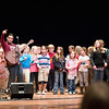 Record-Eagle/Jan-Michael Stump<br /> Songwriter Joe Reilly leads a group of Traverse City area students in a sing-along about the Boardman River during the 9th annual Great Lakes Bionners Conference Friday at Northwestern Michigan College during the multi-venue event.