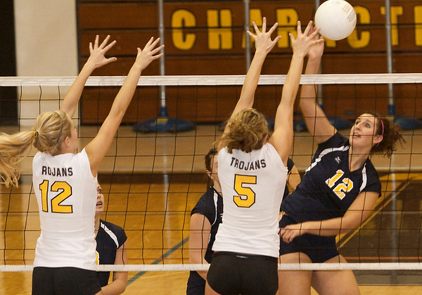 Record-Eagle/Douglas Tesner<br /> Traverse City Central's Katie Fallick (12) and Taylor Besneatte (5) try to block a spike by Cadillac's Ceara Fauble (12).