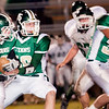 Record-Eagle/Douglas Tesner<br /> Traverse City West's Jay Meyers (22) takes a handoff from sophomore quarterback Isaiah Hackney during Friday's game.