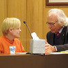 Record-Eagle/Art Bukowski<br /> Joni Holbrook speaks with defense attorney Dean Robb.