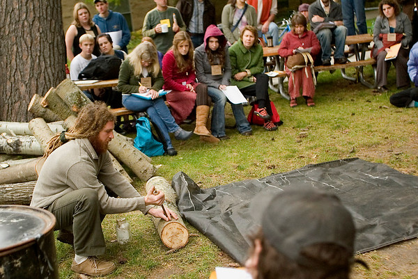 Record-Eagle/Jan-Michael Stump<br /> Brian Rogers demonstrates making mushroom logs during a workshop at the Bioneers Conference Friday.