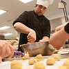Record-Eagle/Douglas Tesner<br /> Brent Boerema prepares cookie dough. TBAISD Career-Tech Center culinary arts facility staff and students, along with some Traverse City Sam's Club employees, baked more than 4,000 cookies for U.S. military troops in Afghanistan and Iraq.