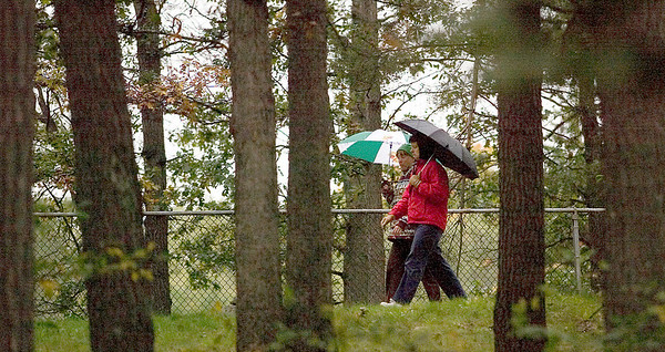 """Record-Eagle/Jan-Michael Stump<br /> Andrea Ballast, left, and Pam Davis walk at the Grand Traverse Civic Center on a rainy Monday afternoon. The two walk every Monday after school at Traverse City Central High School, where they work. """"Rain or shine so far, but we'll see when the snow is up to our knees,"""" said Davis."""