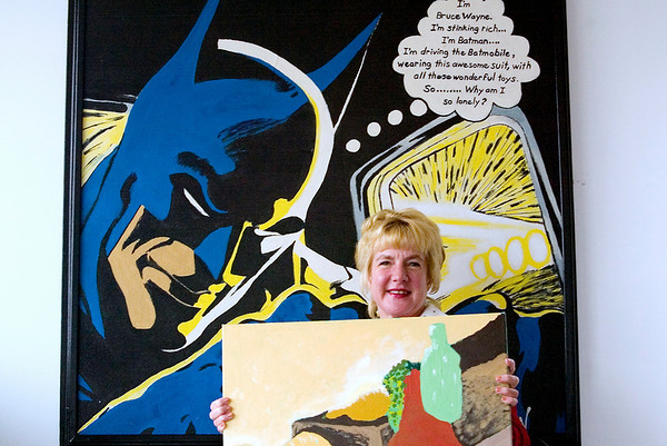 "Record-Eagle/Jan-Michael Stump<br /> Michelle St. Amant sits with two of the paintings that will be displayed during the juried art exhibition, ""A New Dimension,"" at the BATA Transfer Center on Sunday."
