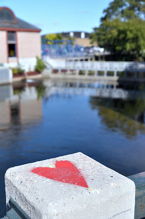 Record-Eagle/Vanessa McCray<br /> This red heart is one of nine heart-shaped symbols painted on columns along a West Front Street Bridge over the Boardman River.