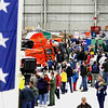 Record-Eagle/Jan-Michael Stump<br /> A crowd lines up to sit inside one of U.S. Coast Guard Air Station Traverse City's HH 65C Dolphin helicopters in the base's hangar during an open house Saturday.