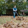 "Record-Eagle/Keith King<br /> Slava Terzeman, of Traverse City, clears leaves and pine needles Monday along East Front Street. ""The fresh air, it's good for the lungs,"" Terzeman said. The forecast calls for cool temperatures and rain through Thursday."