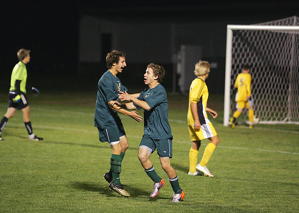 Record-Eagle/Keith King<br /> Traverse City West's Christien Geiger, right, is congratulated by teammate Brandon Montgomery after Geiger scored a second-period goal Tuesday, October 18, 2011 against Traverse City Central.