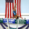 """Record-Eagle/Jan-Michael Stump Traverse City's Suha Augenstein performs her first dive during Thursday's meet against Gaylord. <a href=""""http://photos.record-eagle.com/Sports/Swim-TC-vs-Gaylord-Oct-20-2011/19649789_fwh7TQ"""">More photos from this meet are available here »</a>"""