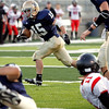 Record-Eagle file photo/Jan-Michael Stump<br /> St. Francis running back Isaiah Schaub finds running room against Lake Michigan Conference rival East Jordan.