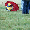 Record-Eagle/Jan-Michael Stump<br /> Naomi Spann, 10, of Rapid City tries to stay dry while waiting for her cousin, Isaac Spann, to run for Kalkaska Middle School during Saturday's Traverse City Central Invitational cross-country meet.