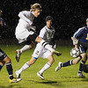 Record-Eagle/Jan-Michael Stump<br /> TC Christian's Jon Tuck puts a shot past the Northport goalie as teammate McKenzie Domine (2) and Northport's Andy Sleder (13) look on.