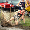 Record-Eagle/Jan-Michael Stump<br /> Manton's Austin Lavigne (89) slips on a muddy corner.