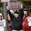 Record-Eagle/Jan-Michael Stump<br /> Kurt Pilon, left, of Traverse City and Jason Potes, of Benzie County respond to a passing car's honk of support as they gathered on Front Street for Saturday's Occupy Traverse City protest.