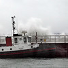 Record-Eagle/Jan-Michael Stump<br /> Waves pushed by winds gusting more than 30 miles per hour Thursday wash over the pier and the Anchor Bay, a training vessel at the Great Lakes Maritime Academy.