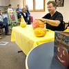 Record-Eagle/Keith King<br /> Patrick Harrison demonstrates his skills and technique in pumpkin carving during a free event at the Kingsley Branch Library.