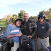 Record-Eagle/Lisa Perkins<br /> Richard Hermel, left, prepares for his first motorcycle ride with the assistance of Bruce Burry, center, and Jerry Orr.