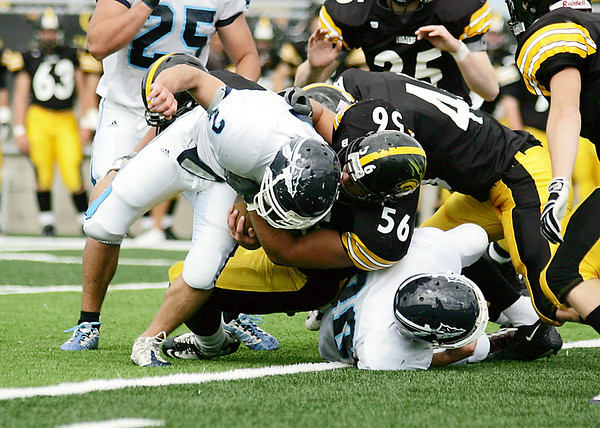 Record-Eagle/Keith King<br /> Traverse City Central's Scott Rademaker tackles Petoskey's Ken Green Saturday, September 18, 2010 at Thirlby Field.