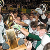 Record-Eagle/Jan-Michael Stump<br /> Traverse City West players celebrate with the Nowak-Olson Trophy following Friday's 51-42 win over Traverse City Central.
