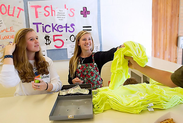 Record-Eagle/Jan-Michael Stump<br /> Traverse City Central ninth graders Hailey Hushak, left, and Molly Whiting sell t-shirts for this Friday's football game against Traverse City West on Tuesday in the Central cafeteria.