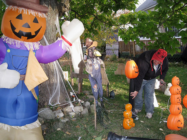 Record-Eagle/Jodee Taylor<br /> Desirae Dine puts together the pumpkin patch for her Halloween-decorated yard in Kingsley.