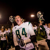 Record-Eagle/Jan-Michael Stump<br /> Traverse City West's Jake Fisher (84)celebrates Friday's 51-42 win over Traverse City Central with teammates and fans.