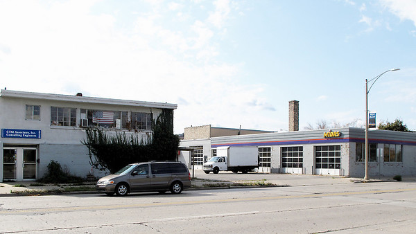 Record-Eagle/Bill O'Brien<br /> A former muffler shop, two other buildings and a pair of parking lots along Grandview Parkway will be the site of a new Hotel Indigo planned for the downtown's Warehouse District. Demolition is slated to begin this fall.
