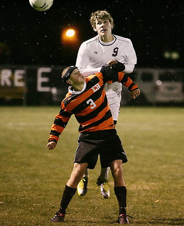 Record-Eagle/Keith King<br /> Traverse City Christian's Peter Mustard, top, puts the pressure on Elk Rapids' Zach Vandeveer Thursday, October 21, 2010 in Elk Rapids.