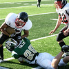 Record-Eagle/Keith King<br /> Traverse City West's Morgan Tolle stops Essex's PJ Baylis Friday, September 10, 2010 at Thirlby Field.