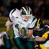 Record-Eagle/Jan-Michael Stump<br /> Traverse City Central's Tim Martin (2) tackles  Traverse City West's Ronnie Saunders (44) in the second half of Friday's game.