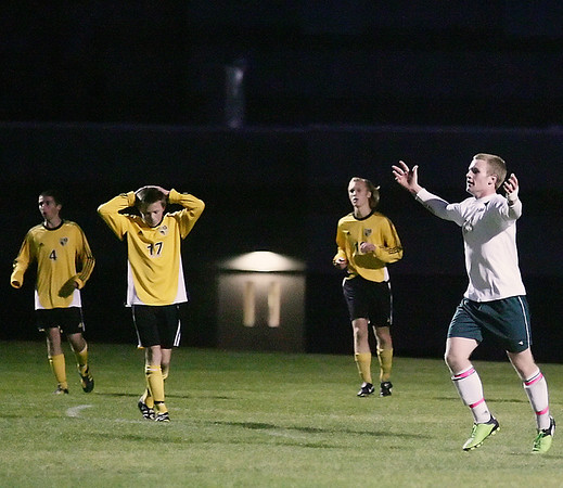 Record-Eagle/Keith King<br /> Traverse City West's Sean McPherson, right, celebrates after scoring a goal in the first half.