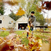 "Record-Eagle/Keith King<br /> Francine Leutz, of Temperance, uses a leaf blower to clear leaves from the yard of her son, who wasn't home, at his residence in Traverse City. Francine, along with her husband, is visiting her son, daughter-in-law and grandchildren. ""He won't be surprised, he knows his mother,"" Leutz said of her outdoor chore."