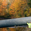 Record-Eagle/Jan-Michael Stump<br /> Ray Hogarth, of Kal Excavating, helps guide a temporary pipe into Northport's Mill Pond near the intersection of 3rd Street and Park Drive on Tuesday afternoon. The pipe will help control sediment during a dredging project that will take place over the next two to three weeks, after which the pipe will be removed and the flow of Northport Creek will return to normal.
