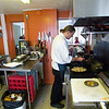Record-Eagle/Jan-Michael Stump<br /> Chef and proprietor Eric Patterson works in the kitchen at The Cook's House during a Wednesday lunch. The restaurant has moved from its former location on East Front Street to nearby Wellington Street, combining with the Wellington Street Market to give The Cook's House 10 more seats and triple its kitchen space.