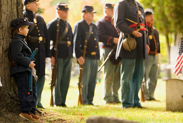 Record-Eagle/Jan-Michael Stump<br /> Levi Cummings, 4, of Alden, watches as the gravesite of Sgt. John P. Sinclair is rededicated.