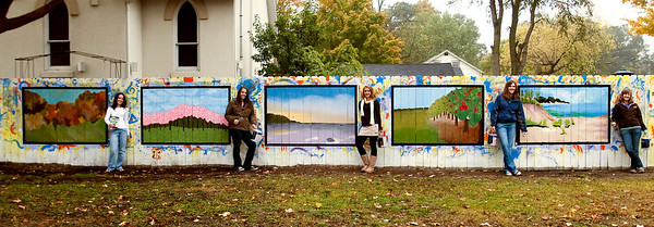 Record-Eagle/Douglas Tesner<br /> Megan Irons, from left, Elizabeth Bartlett, Megan Thompson, Corinn Lewis and Abby Horness show their panels on a mural they painted at Studio 7 Arts in Traverse City.