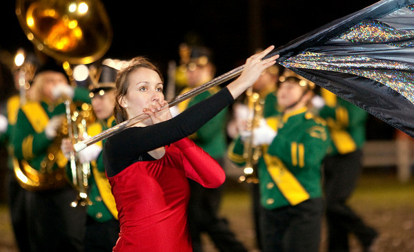 Record-Eagle/Douglas Tesner<br /> Natalie Lambert, a Traverse City West senior and Color Guard captain, performs during the half-time show.
