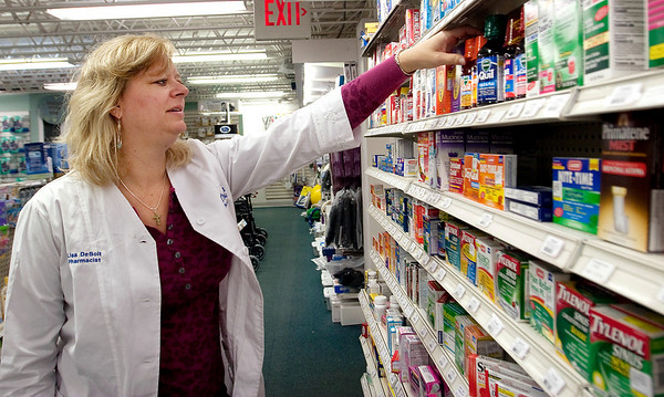 Record-Eagle/Douglas Tesner<br /> Lisa DeBolt checks the over-the-counter flu and cold medications at Thompson Pharmacy on Union Street in Traverse City.