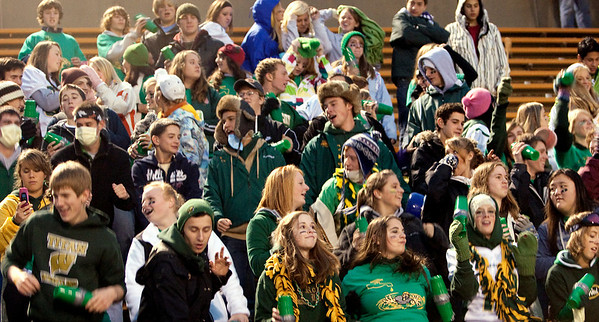 Record-Eagle/Douglas Tesner<br /> Traverse City West fans cheer for their team.