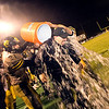 Record-Eagle/Jan-Michael Stump<br /> Traverse City Central coach Tom Passinault gets a water bath at the end of Friday night's win over Traverse City West.