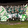 Record-Eagle/Douglas Tesner<br /> The Traverse City West football team breaks through a banner at the beginning of Friday's game.