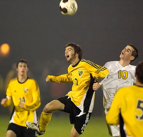 Record-Eagle/Jan-Michael Stump<br /> TC Central's Jordan deTar (middle) and West's Jon Spencer (right) fight for the ball in the second half.