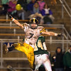 Record-Eagle/Jan-Michael Stump<br /> Traverse City Central's Michael Heim (7) breaks up a pass for Traverse City West's Jake Fisher.