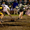 Record-Eagle/Jan-Michael Stump<br /> Traverse City Central's offense lines up against Traverse City West's defense on a mud-covered Thirlby Field FRiday night.