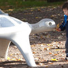Record-Eagle/Douglas Tesner<br /> Jacob Fisher, 2, tries to feed some fallen leaves to one of the large turtles in Clinch Park. Jacob and his family, of Lansing, were in the area visiting.