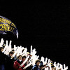 Record-Eagle/Jan-Michael Stump<br /> Traverse City Central fans wave spirit sticks during Friday's game against Traverse City West.
