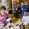 Record-Eagle/Keith King<br /> Lisa Madden, of Lapeer, looks at a book as her husband, Chuck, browses at Brilliant Books.