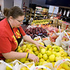 Record-Eagle/Keith King<br /> Jessica Strouse sorts local apples at the TC Produce Market.