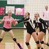 Record-Eagle/Keith King<br /> Traverse City Central's Brittany Bell, middle, hits the ball as teammate Brianna Podsaid, right, runs near against Traverse City West Wednesday, October 26, 2011 at Traverse City West High School.